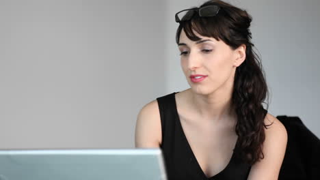 A-woman-types-on-her-laptop