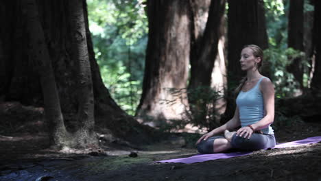 A-woman-sits-alone-in-the-forest-and-meditates
