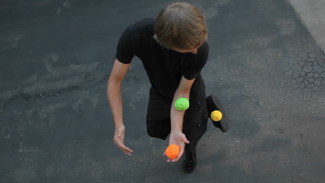 A-man-juggle-balls-on-his-arms-hands-and-feet