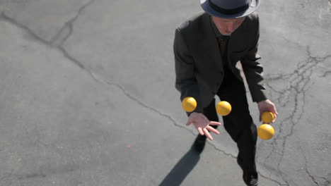 A-man-does-a-juggling-act-in-the-street