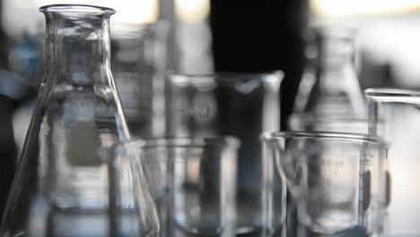 Scientific-glass-beakers-coming-into-focus