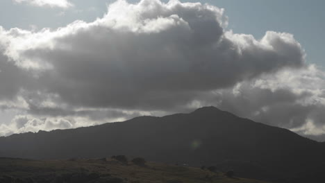 Storm-clouds-pass-over-a-hilly-area