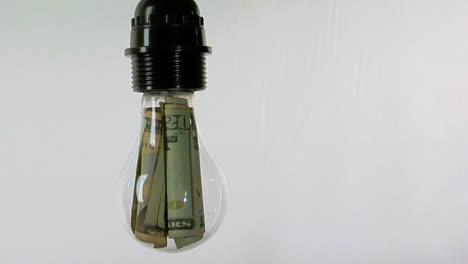 A-light-bulb-contains-twentydollar-bills