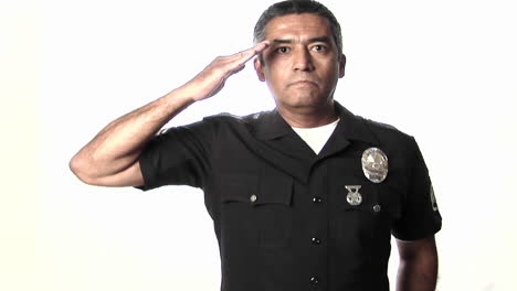 A-police-officer-salutes-then-stands-at-ease