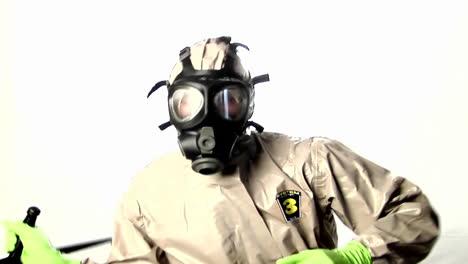 A-man-in-a-hazmat-suit-speaks-into-a-walkietalkie-1