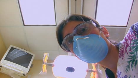 A-dental-hygienist-finishes-cleaning-a-patient-s-teeth-from-a-POV-of-the-patient