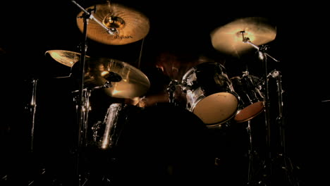 A-drummer-plays-on-a-darkened-stage