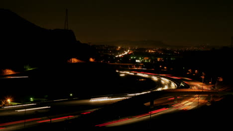 Vehicles-drive-on-a-freeway-at-night-in-fast-motion-1