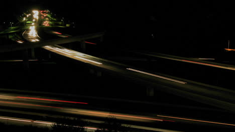 Vehicles-drive-on-a-freeway-at-night-in-fast-motion-2