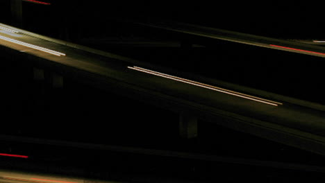 Vehicles-drive-on-a-freeway-at-night-in-fast-motion-3