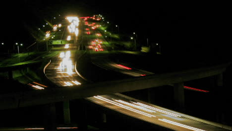 Vehicles-drive-on-a-freeway-at-night-in-fast-motion-4