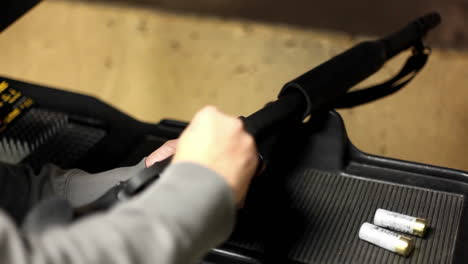 A-man-loads-a-rifle-at-an-indoor-shooting-range