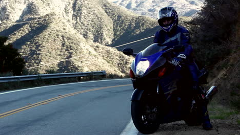 Motorcyclist-pulls-out-onto-a-winding-mountain-road