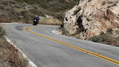 Motorcycle-and-cars-on-winding-mountain-road