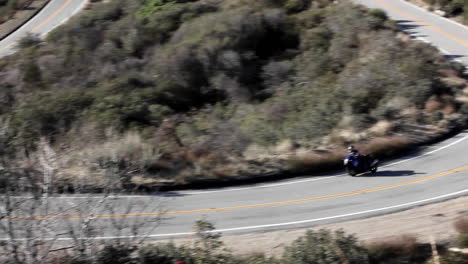 Motorcycle-and-cars-on-winding-mountain-road-1