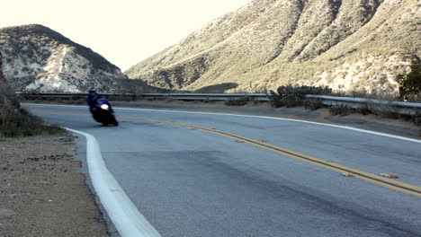 Motorcycle-and-cars-on-winding-mountain-road-2