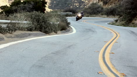 Motorcycle-and-cars-on-winding-mountain-road-3
