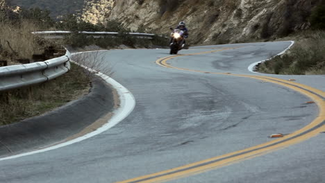 Motorcycle-and-cars-on-winding-mountain-road-5