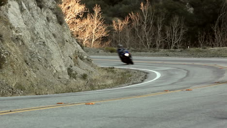 Motorcycle-and-cars-on-winding-mountain-road-6