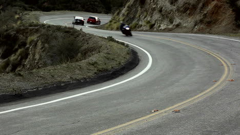 Motorcycle-and-cars-on-winding-mountain-road-7