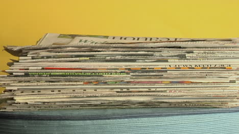 Newspapers-stack-up-on-a-table-in-time-lapse