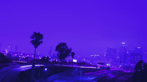 Excellent-shot-of-heavy-traffic-driving-on-a-busy-freeway-in-Los-Angeles-at-night