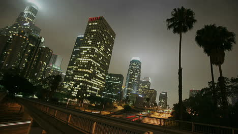 Excellent-shot-of-heavy-traffic-conduciendo-on-a-busy-freeway-in-downtown-Los-Angeles-at-night