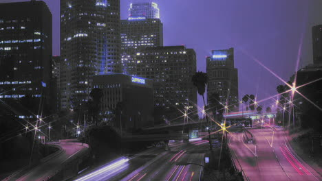 Excellent-shot-of-heavy-traffic-driving-on-a-busy-freeway-in-downtown-Los-Angeles-at-night-1