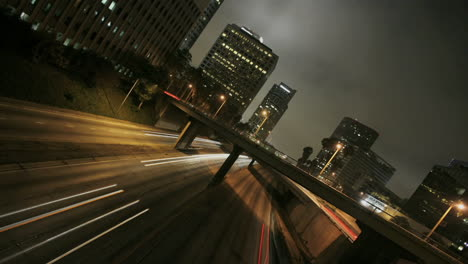 Excellent-shot-of-heavy-traffic-conduciendo-on-a-busy-freeway-in-downtown-Los-Angeles-at-night-2