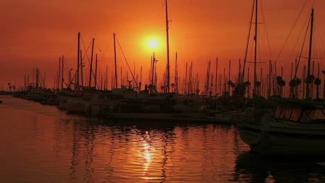 A-harbor-reflects-sunlight-during-the-golden-hour-in-time-lapse