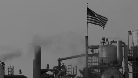 Smoke-moves-across-the-sky-in-an-industrial-area-in-a-black-and-white-shot