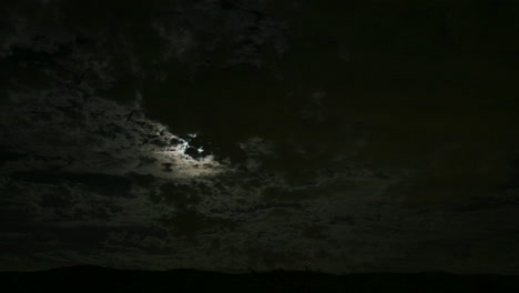 Dark-clouds-move-across-the-moon-in-this-haunting-scene