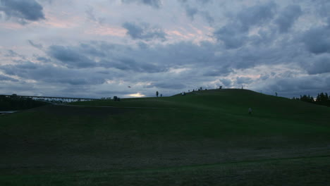Clouds-and-people-move-across-the-sky-behind-a-landfill