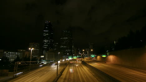 A-beautiful-shot-of-time-lapsed-freeway-traffic-in-a-downtown-area