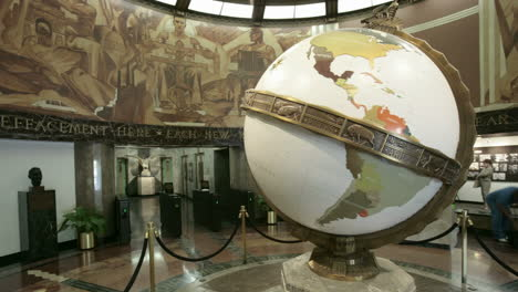 A-large-globe-turns-in-a-museum-or-planetarium