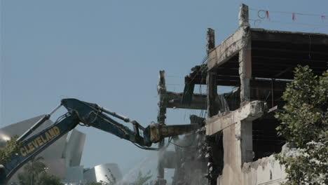 A-construction-bulldozer-destroys-a-building-in-time-lapse