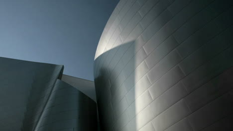 A-time-lapse-shot-of-shadows-moving-across-a-modern-piece-of-architecture