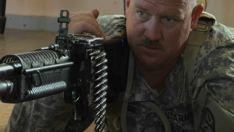 A-man-prepares-to-fire-an-automatic-weapon