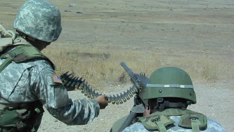 A-soldier-fires-an-automatic-weapon