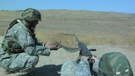 A-soldier-fires-an-automatic-weapon-1