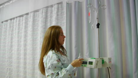A-nurse-prepares-IV-equipment