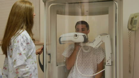A-nurse-encloses-a-patient-in-a-medical-machine