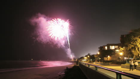 Fireworks-explode-off-a-beach-in-time-lapse