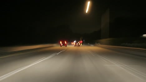 A-car-speeds-along-a-highway-at-night-in-time-lapse
