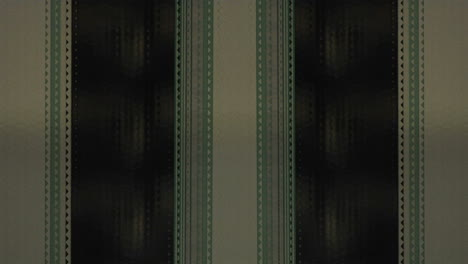 A-strip-of-film-runs-vertically-1