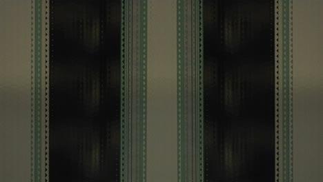 A-strip-of-film-runs-vertically-1