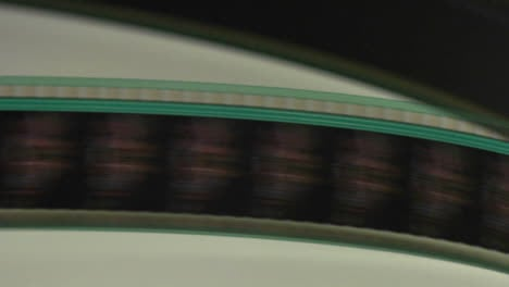 A-film-strip-spool-through-a-projector-in-this-abstract-shot
