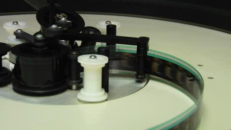 Film-spools-through-a-projector