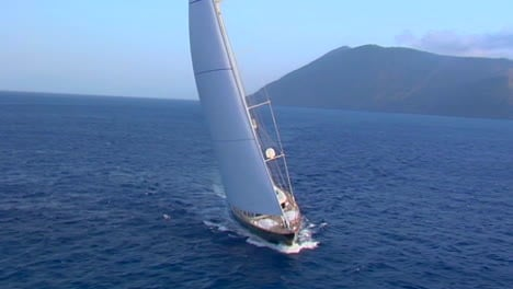 A-magnificent-aerial-shot-over-a-large-sailboat-at-sea