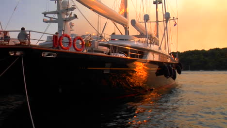 Sunset-light-reflects-on-the-side-of-a-moored-sailboat